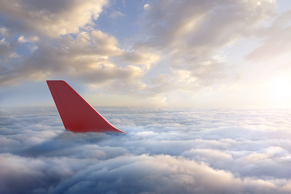 Airplane Rudder Above Clouds Photograph by Chris Clor