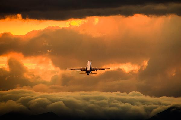 Airplane sunset Photograph by Serizawa