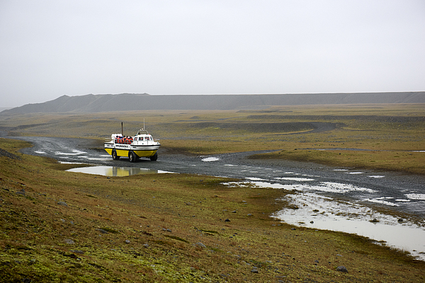 Amphibious vehicle and a group of tourists visiting Jokulsarlon lagoon, Eastern Iceland Photograph by Feifei Cui-Paoluzzo