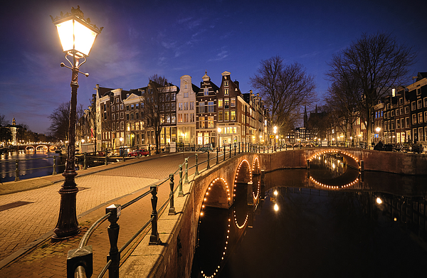 Amsterdam canals and typical canal houses at dusk Photograph by 1111iespdj