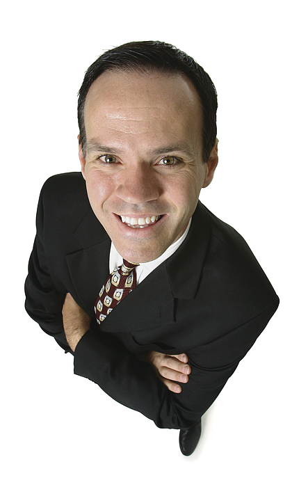 An Adult Caucasian Business Man In A Suit Folds His Arms And Smiles Up At The Camera Photograph by Photodisc