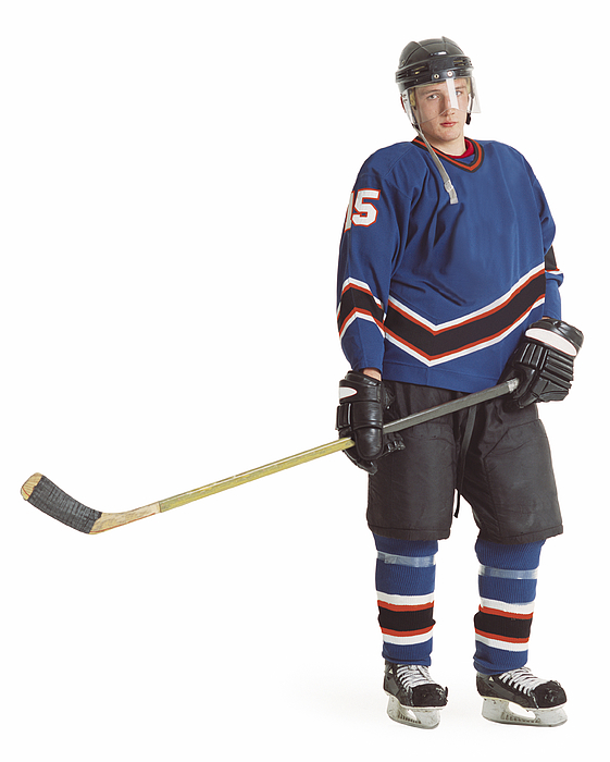 An Adult Caucasian Male Hockey Player In A Blue Jersey Stands With His Stick Extended And Displays A Stern Look Photograph by Photodisc
