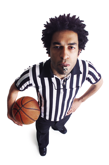 An African American Male Referee Blows His Whistle As He Looks Up At The Camera Photograph by Photodisc