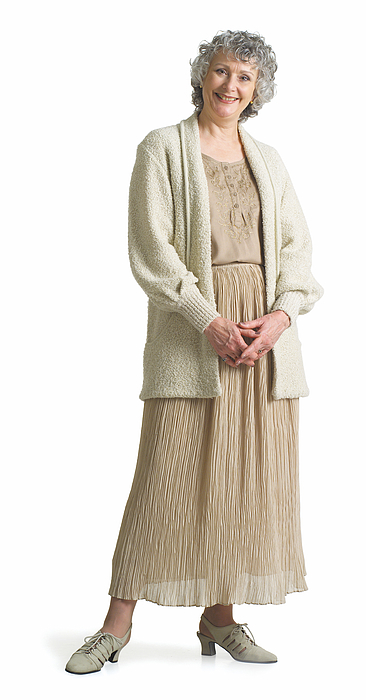 An Elderly Woman Dressed In A Beige Dress Looks At The Camera As She Smiles. Photograph by Photodisc