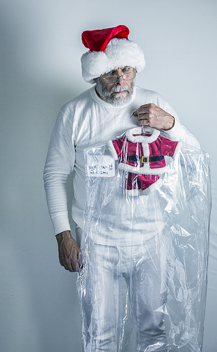 Angry Santa Claus Holding Shrunken Dry Cleaned Santa Costume Photograph by Willowpix