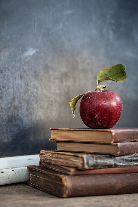 Apples On Stack Of Books Photograph by Leslie Banks / EyeEm