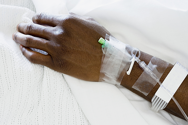 Arm of patient with drip Photograph by XiXinXing