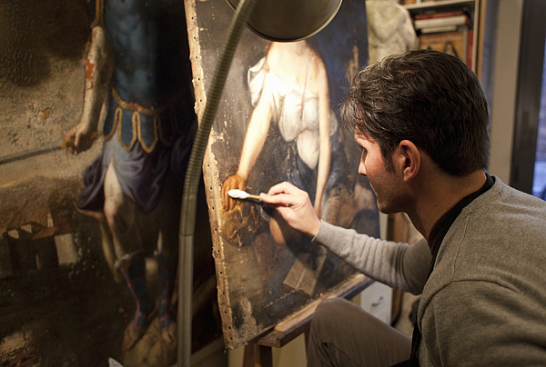 Artist Restoring A Painting In His Studio Photograph by Kathrin Ziegler