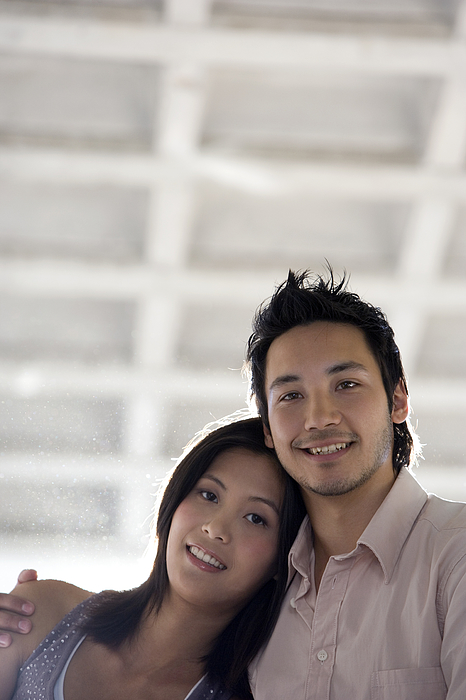 Asian couple hugging Photograph by Klaus Tiedge