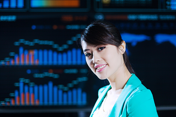 Asian successful office lady portrait with digital chart graph background Photograph by Loveguli