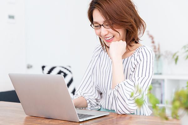Asian Woman Using Laptop Photograph by Miya227