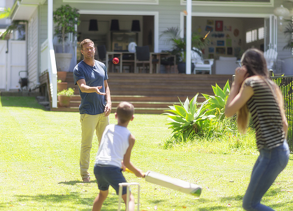 Australian family playing cricket Photograph by Funky-data