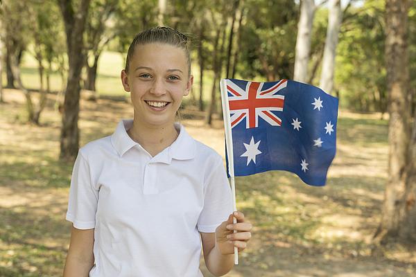 Australian Flag Waving by Junior High School Girl Student for Australia Day Photograph by Davidf