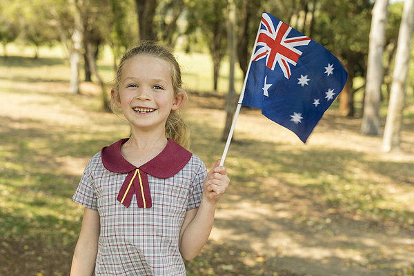 Australian Flag Waving by Primary School Girl Student for Australia Day Photograph by Davidf