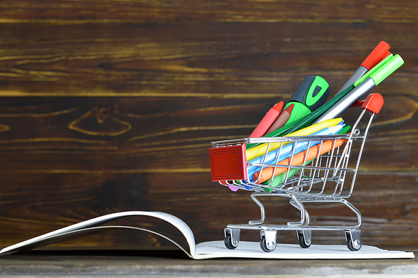 Back to school. School supplies in shopping cart Photograph by Izzzy71