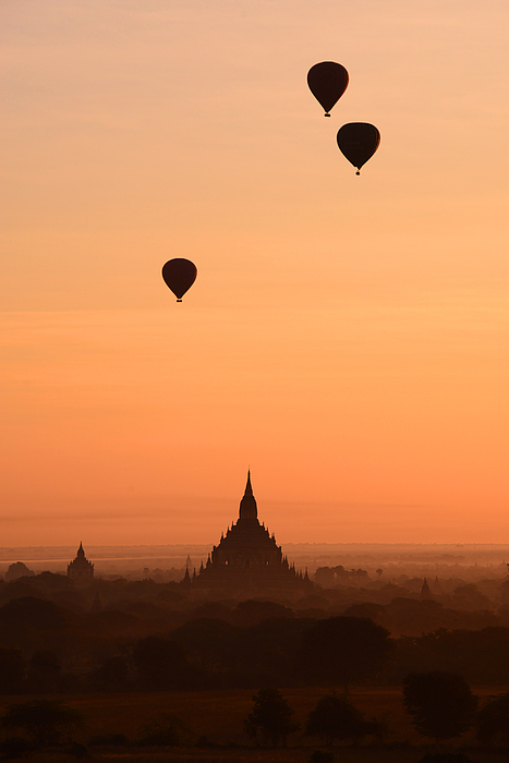 Balloons flying over Bagan, Myanmar Photograph by February