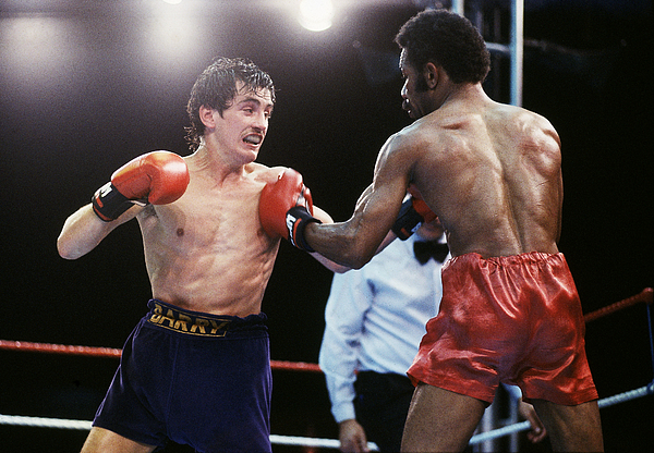 Barry McGuigan of Northern Ireland in action against WBA Champion Eusebio Pedroza of Panama Photograph by Steve Powell