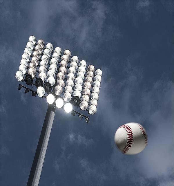 Baseball home run under the stadium lights Photograph by Pgiam