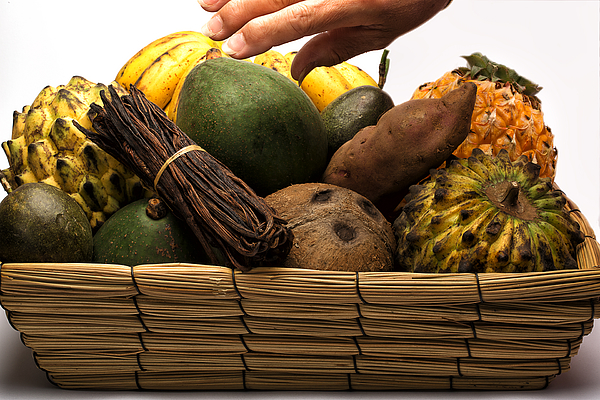 Basket of assorted exotic fruits Photograph by Jean-Marc PAYET