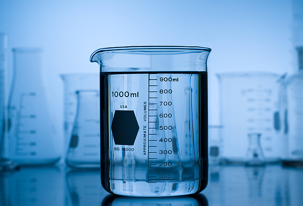 Beaker on Blue Gradient with Lab Glass Background Photograph by ElementalImaging