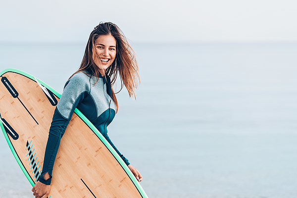 Beautiful Female Surfer, With Copy Space Photograph by Pixelfit