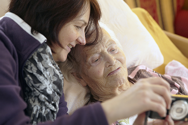Bedridden Grandmother With Granddaughter Photograph by Martin Leigh