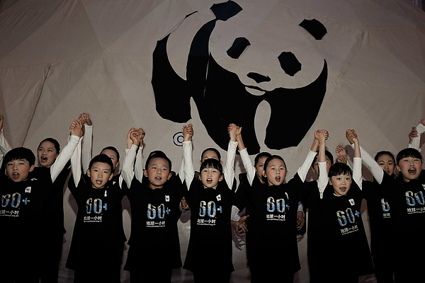 Beijing Goes Dark For Earth Hour Photograph by Lintao Zhang