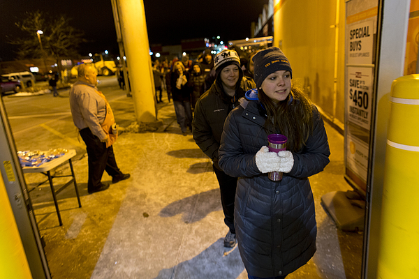 Black Friday Shoppers Look For Holiday Bargains Photograph by Darren Hauck