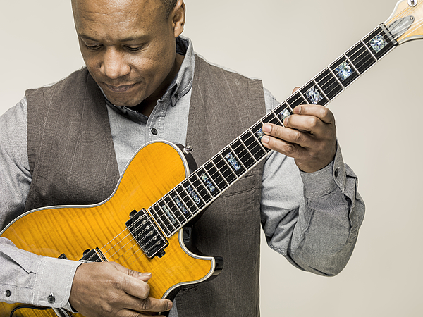 Black male playing guitar Photograph by Colin Hawkins
