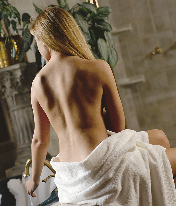 Blonde Woman Getting Ready To Take A Bath Photograph by Photodisc