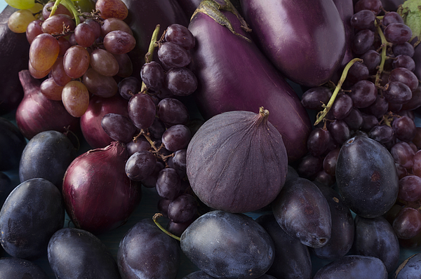 Blue and purple food. Background of fruits and vegetables.  Fresh figs, plums, onions, eggplant and grapes. Top view. Photograph by Kitamin