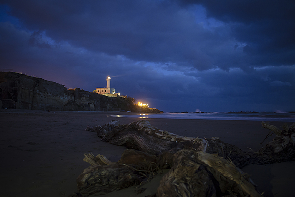 Blue hour under the lighthouse Photograph by Adriano Ficarelli