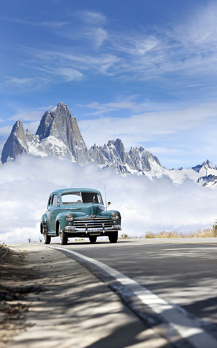 Blue Sky Over Antique Car Driving In Patagonia Argentina Photograph by Grafissimo