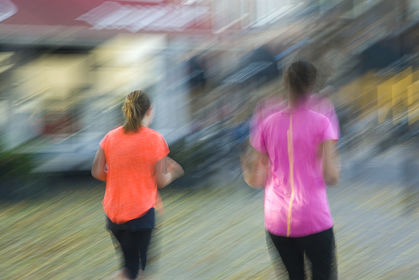 Blurred image of two female joggers Photograph by Lyn Holly Coorg