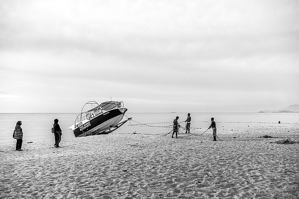Boat activities over Batu Feringgi beach at Penang, Malaysia. Black and white. Photograph by Shaifulzamri