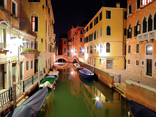 Boats in canal Photograph by Bernd Schunack