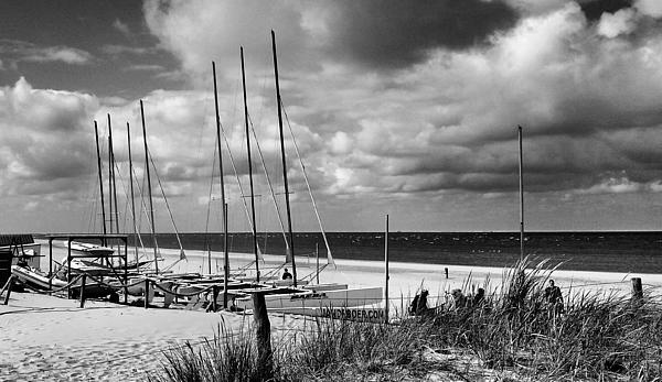 Boats Moored Against Cloudy Sky On Beach Photograph by Bianca Katteler / EyeEm