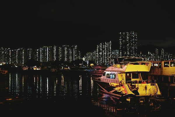 Boats Moored On Sea By Illuminated City Against Clear Sky At Night Photograph by Naphatchon Sonthipak / EyeEm