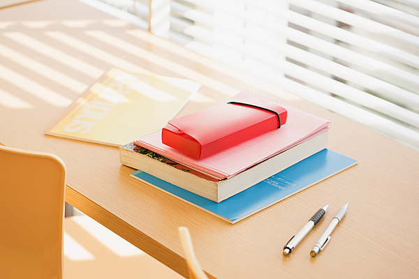 Books and pens on desk Photograph by Image Source