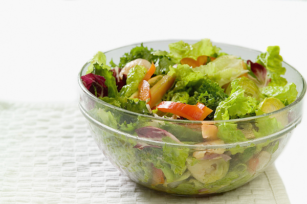 Bowl of salad with shrimp and vegetables sitting on a paper towel, close-up, part of Photograph by Medioimages/Photodisc