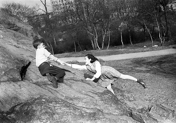 Boy and girl (10-11) playing in park Photograph by George Marks