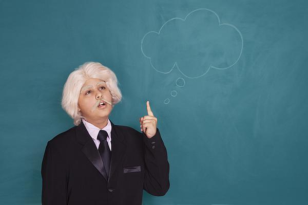Boy dressed as Einstein thinking Photograph by Sudipta Halder
