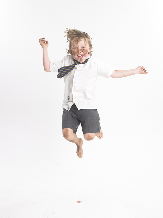 Boy jumping Photograph by Devon Strong