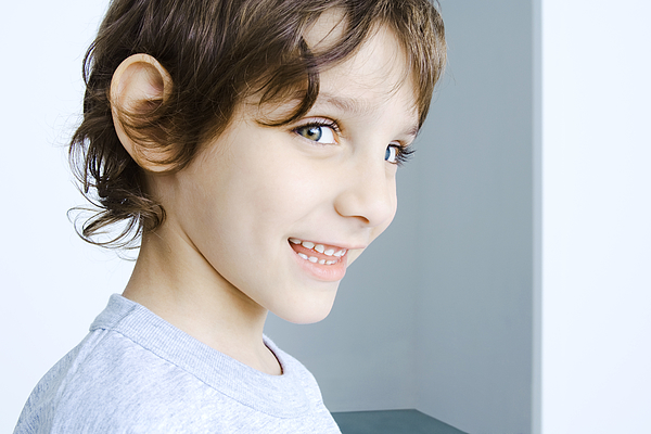 Boy smiling at camera, head and shoulders, portrait Photograph by PhotoAlto/Michele Constantini