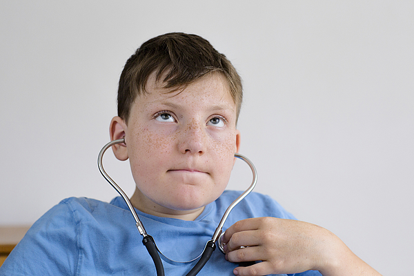 Boy using a stethoscope Photograph by Gombert, Sigrid/science Photo Library
