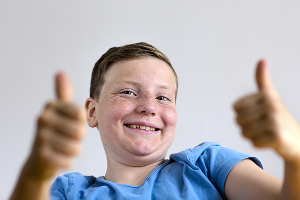 Boy with thumbs up Photograph by Gombert, Sigrid/science Photo Library