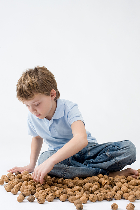Boy with walnuts Photograph by Image Source