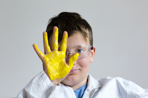 Boy with yellow paint on hand Photograph by Gombert, Sigrid/science Photo Library