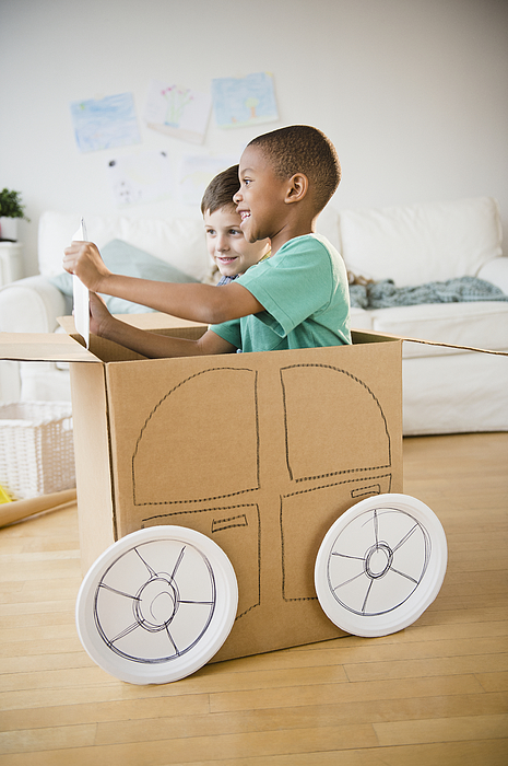Boys Playing In A Cardboard Car Together Photograph by Blend Images - JGI/Jamie Grill