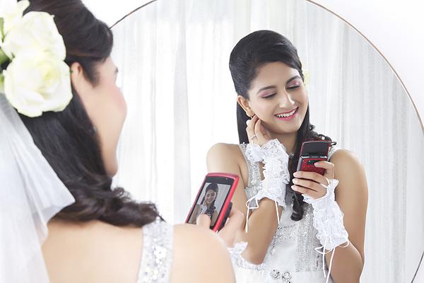 Bride admiring her own photograph Photograph by Sudipta Halder